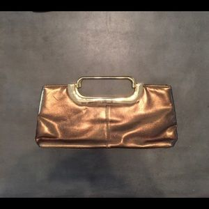 Handbags - Leather clutch in copper with metal handles